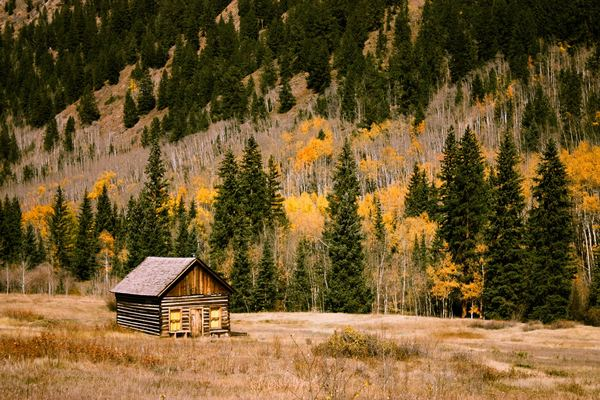 Cabin on mountain in the fall season