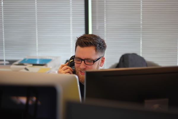 Man on the phone in an office setting