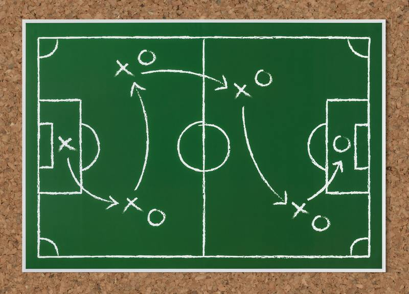 soccer play drawn on a chalkboard