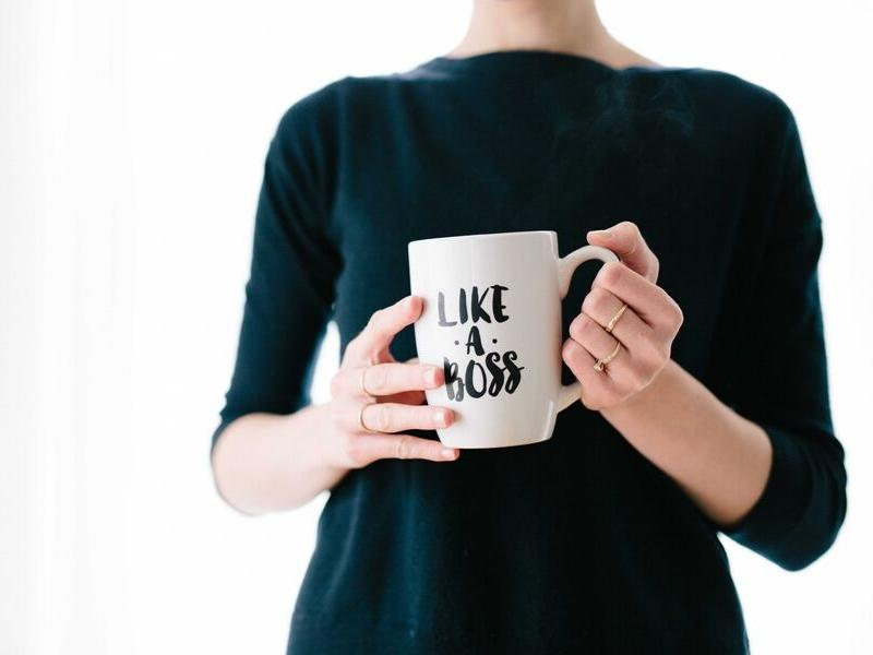"Woman Holding ""Like a Boss"" Mug"