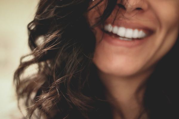 close up photo of woman smiling
